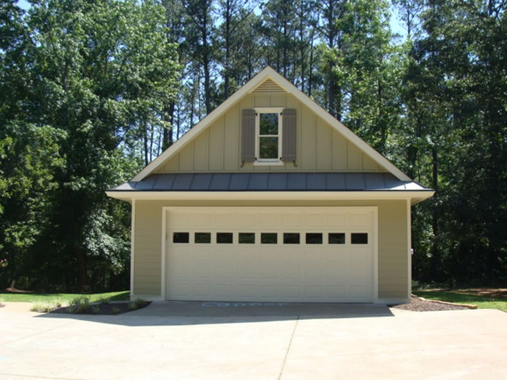 This photos served as inspiration for the garage. We don't have a window above, but we will have two large columns coming down each side.