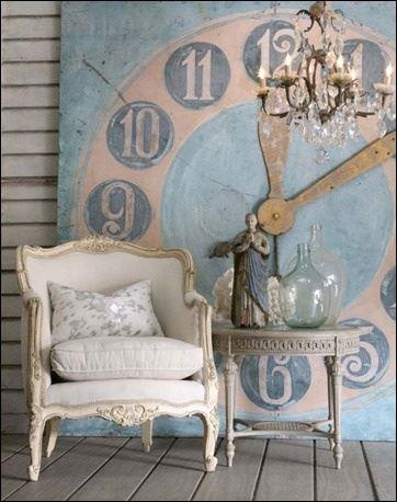 """I saw this GORGEOUS photo on Pinterest and pinned it immediately. I loved the idea of a REALLY BIG clock. And while our porch won't be quite this """"girlie,"""" I used this photo as inspiration. When I was shopping at a local store, I came upon the clock below. It is huge (not as big as this one in the photo), but I bought it and it will be our statement piece on the porch. Had I not seen this photo, I would not have had it in my head to even be on the lookout for something similar."""
