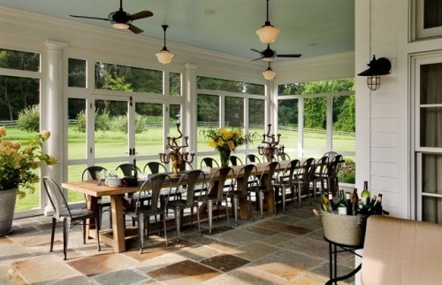 This is the photograph I come back to again and again. There's so much I like about this porch, but mainly it's the look of the floor, the trim with the screens, and the bronze ceiling fixtures. We have a vaulted ceiling, so it will look a bit different, but many of the elements will serve as inspiration.