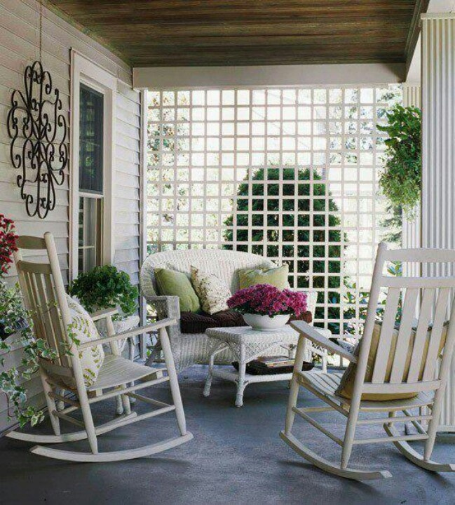"This is one of several photos I pinned as an example of adding a ""privacy fence"" to one side of our porch. The finished look of it, whether it's a trellis or part trellis, is important to adding a little bit of character to the opposite side of the porch."