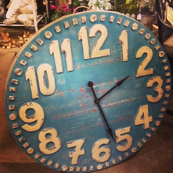 This is the clock I ended up buying for the porch. Fun, blue, a little girlie (but not too much), and it's deceiving in this photo. It is actually enormous.