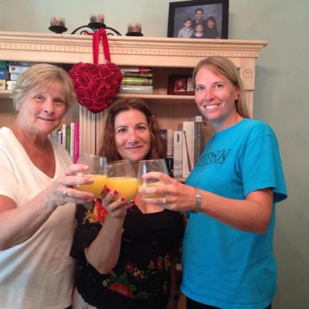 Chip (l), Leeanne (r) and me toasting our contract with Mimosas.