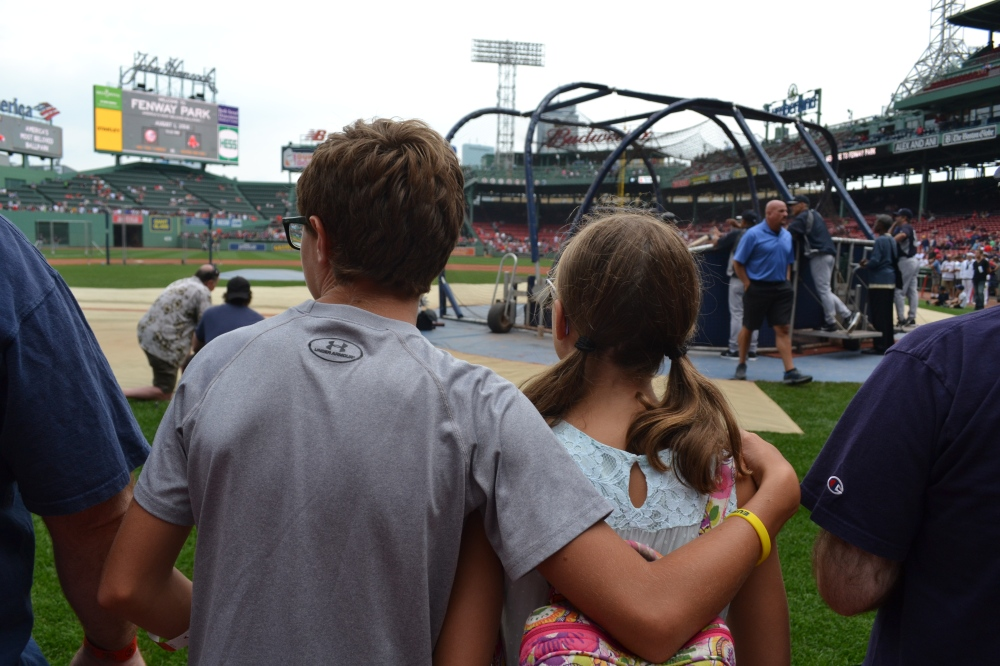 Captured this moment at Fenway Park...my son with his arm around his sister during batting practice.