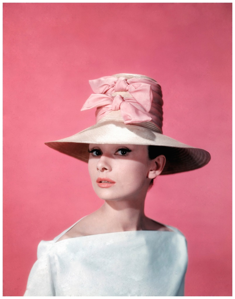 Publicity portrait of Belgian-born American actress Audrey Hepburn (1929 - 1993) as she wears a wide-brimmed hat and white blouse during the filming of the film 'Funny Face' directed by Stanley Donen, 1957. (Photo by Paramount Pictures/Courtesy of Getty Images)