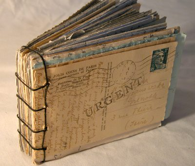 These postcards were collected over time and bound into a book. What a great idea! For more, visit Clabbetravels.com.  http://tipsoftravelling.com//?s=postcard