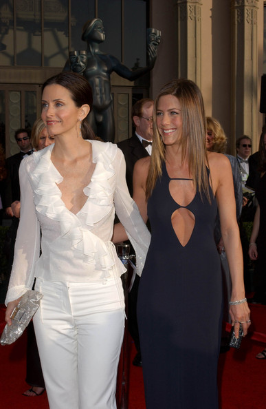 Courtney Cox in white blouse and white pants (with Jennifer Aniston)