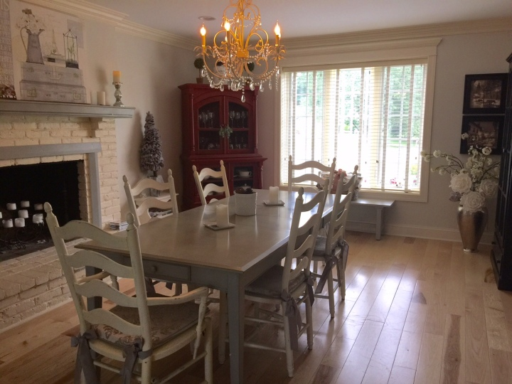 The room today. We still have work to do in the dining room (recraft the fireplace and add built-in cabinets), but the table has changed the feel of the room entirely. It's much more calming with the grey tones, and the table came out so well. Don't be afraid to give new life to an older piece.