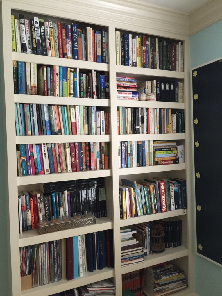 The bookshelf in our home office.