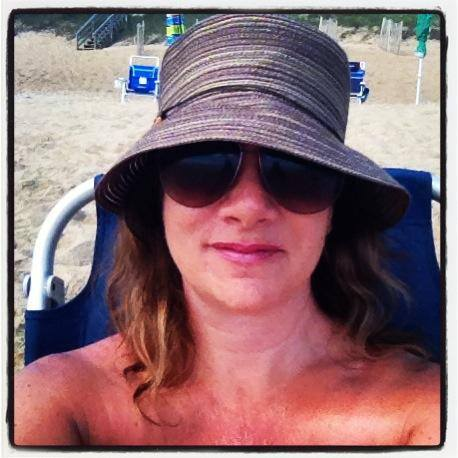 My brown and tan floppy beach hat.